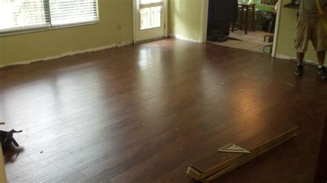 this is my new swiftlock handscraped chestnut hickory laminate floor getting installed today by