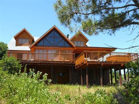 bakatad lodge luxury log home with lake and mountain views 13793