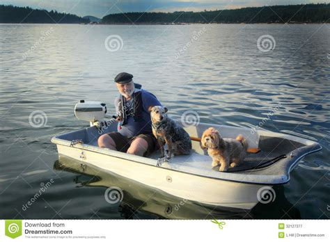 Dog Motor Boat by Boater With Dogs On Small Boat Royalty Free Stock