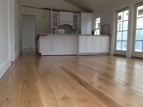 amagansett wide plank white oak installed finished with bona traffic transitional
