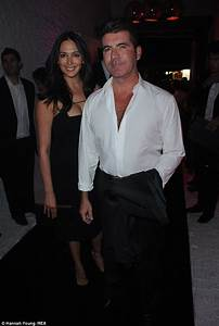Simon Cowell wears his shirt open as he takes Lauren ...