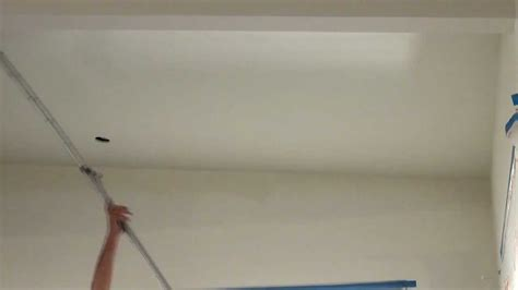 how to spray paint a ceiling using an airless sprayer then back rolling