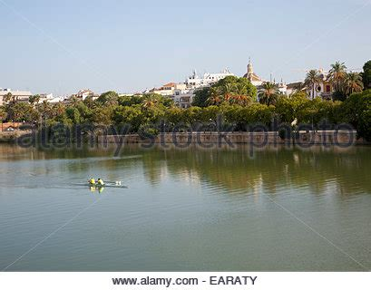 Boat In Spanish Rowing by Seville Spain Rowing On The River Guadalquivi Which Runs