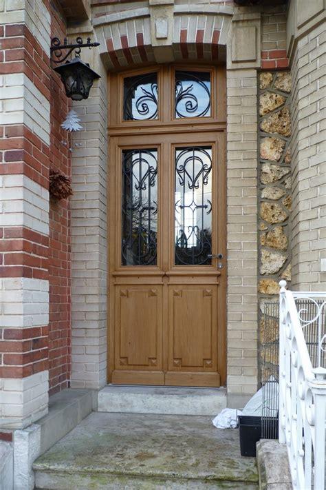 portes d entr 233 e en bois massif avec grilles en fonte