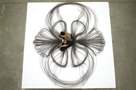 artist uses movements to create stunning charcoal drawings