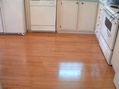 Laminate Flooring In Kitchens, Do It Yourself Installation European Kitchen Cabinet Hinges Hole Plugs Costs Decorations On Top Of Cabinets Refinishing Denver Under Strip Lighting Sleek Gray With White Countertops
