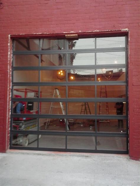 Anodized Aluminum & Clear Tempered Glass Garage Doors