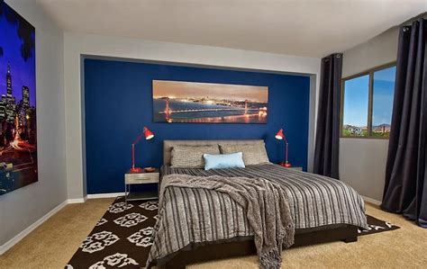 Masculine-bedroom-for-men-with-blue-wall-decor-and-black Colorado Vacation Homes Rentals Best Places To Rent A Home New Orleans Rental Small Single Wide Mobile For Sale Disney World Charleston Sc But Beautiful With Loft