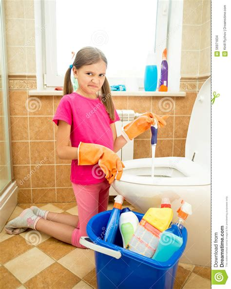 Girl Cleaning Toilet With Disgust Stock Photo Image