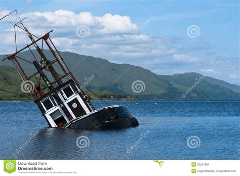 Dream Of Your Boat Sinking by Partially Submerged Fishing Vessel In Loch Linnie Stock