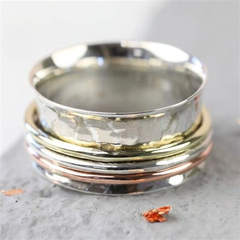 Mixed Metal Hammered Effect Spinning Ring  Love My Gifts. Love Story Engagement Rings. Neil Lane Wedding Rings. Precious Gemstone Wedding Rings. Creative Unique Wedding Engagement Rings. Parent Wedding Rings. Ring Ceremony Wedding Rings. Maori Wedding Rings. Affordable Engagement Wedding Rings