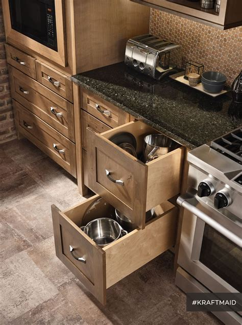 easy access kitchen storage for big pots and pans and since 90 lb capacity drawer slides are