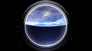 Earth as seen through window of International Space ...