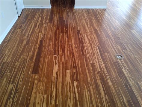 tiger stripe strand bamboo installation in ballantyne eclectic by the hardwood
