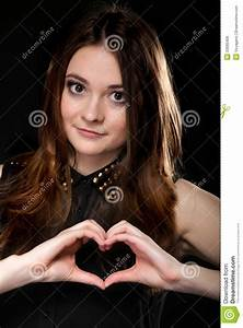 Girl Doing Heart Shape Love Symbol With Her Hands. Stock ...