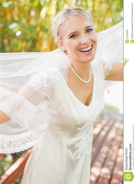 Pretty Happy Blonde Bride Holding Her Veil Out Smiling At. Buy Wedding Invitations Dublin. Wedding Reception Venues St Paul Mn. Wedding Musicians Canberra. Wedding Anniversary Logo. Wedding In Usa Cost. Wedding Invitations Full Names. Wedding Gowns Plus Size. Online Wedding Planner And Organizer