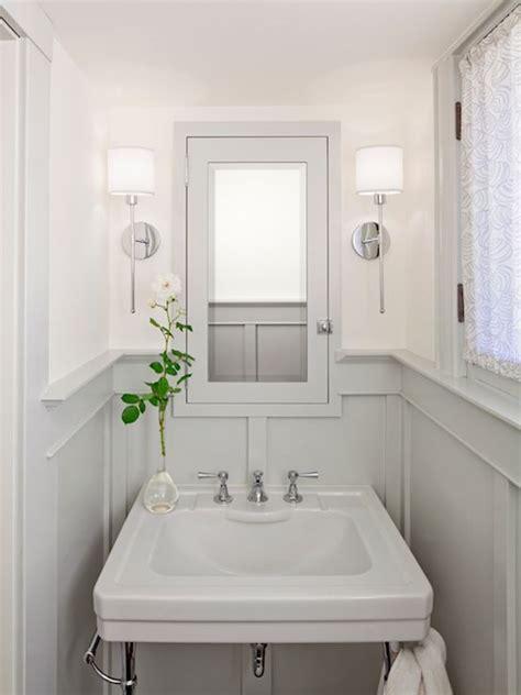 bathrooms chrome sconces fixtures gray wainscoting gray pedestal sink gray medicine cabinet