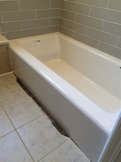 need help with a 2 inch gap between my new tub and the tile floor