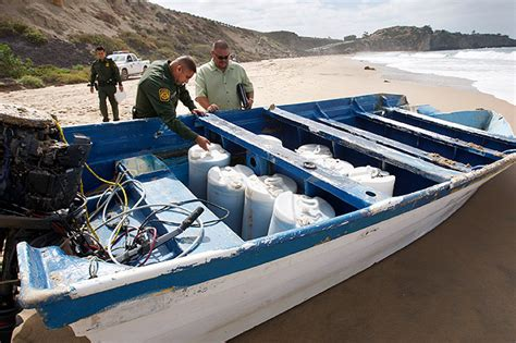 Panga Boat Lands In Crystal Cove by 14 Illegal Immigrants Held After Boat Flips In Surf Off O