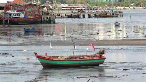 Small Boat In Hindi by Homer Ak Circa 2012 Slanting Sunlight Illuminates An