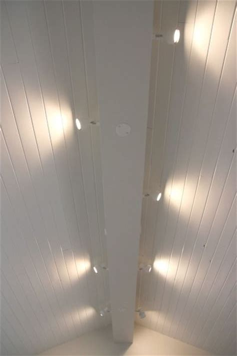 track lighting installed to wash the vaulted ceiling with light and provide indirect ambiance