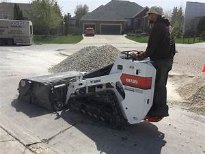 Mini skid steer Bobcat service - The Lawn Salon